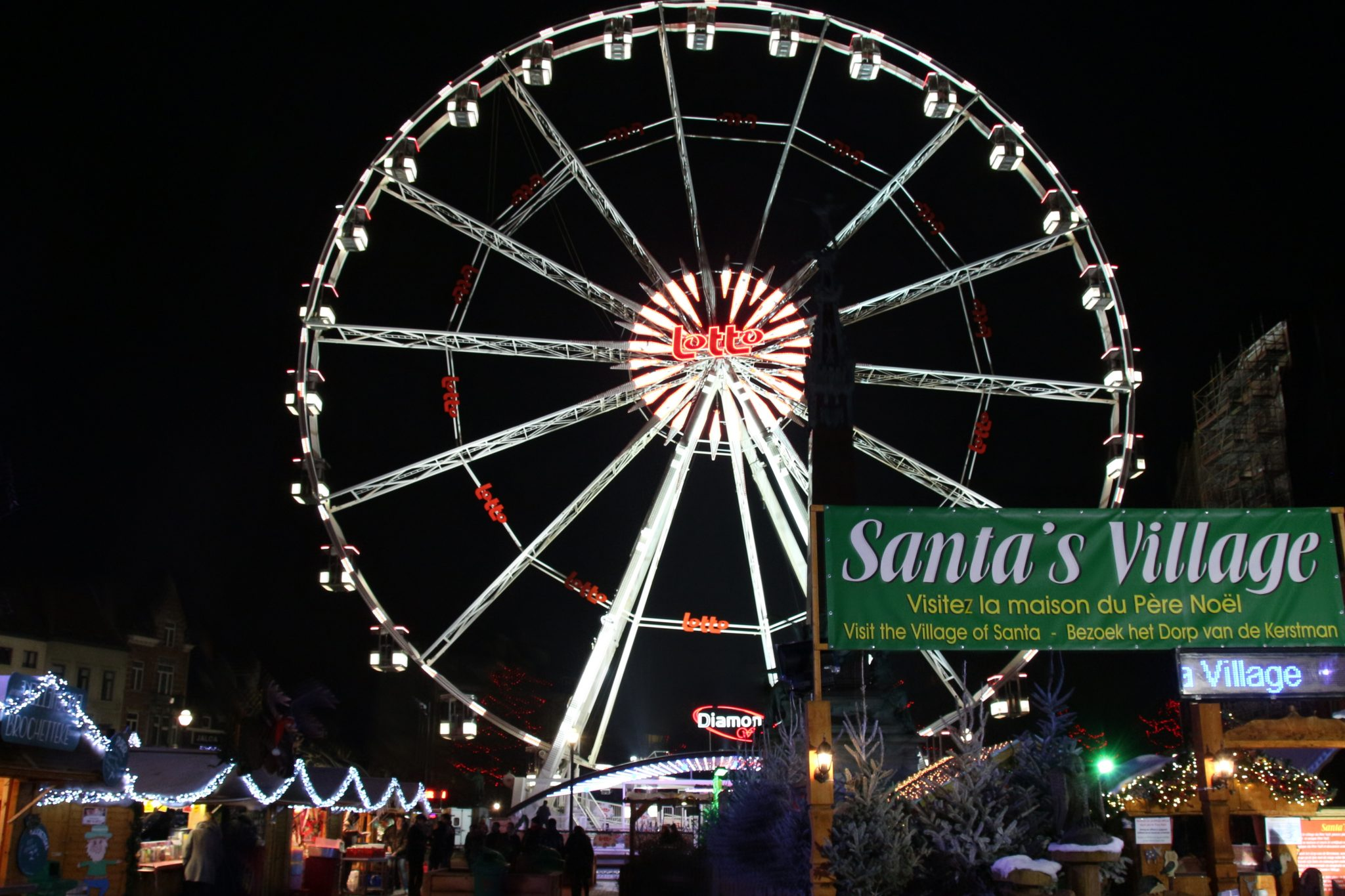 Ferris wheel and Santa's Village at the Christmas Market in Brussels, Belgium
